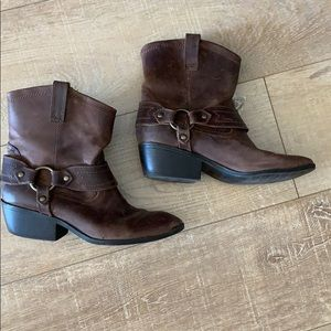 Brown ankle cowboy style boot.
